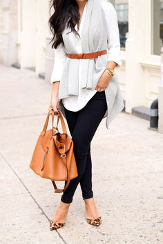 The key to layering is matching your color scheme. White, grey, camel, and a hint of leopard is the perfect combination.