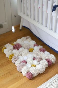 How To Make A Pom Pom Rug - great way to use leftover yarn.