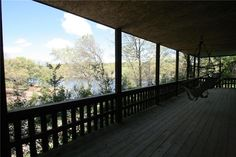 Lake front home view in Bella Vista, AR with a community heated dock! See more Bella Vista lake homes for sale with access to a community dock on the website! http://www.tnecessary.remaxarkansas.com/bella-vista-ar-lake-homes-with-community-dock.aspx