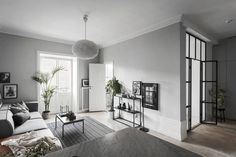 Monochrome home with a glass bedroom wall - via Coco Lapine Design