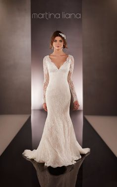 Choose a Lace shoulder strap or long illusion lace sleeve dress with scalloped lace edging and low back zip up under Lace-covered buttons.