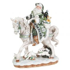 This striking centerpiece Santa Figurine on a Horse represents the first-class standard of design & quality you have come to expect from Fitz and Floyd Santa Figurines. Exceptional details combine with a pastel green and ivory color palette to create a unique focal point for your holiday home decor. Santa Claus sits astride his snowy white steed while carrying his sack of toys, and is surrounded by leaping snow white rabbits. A truly luxurious holiday centerpiece!