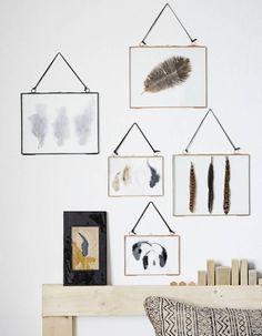 Des cadres muraux en verre et en laiton