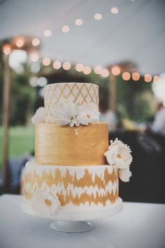 Gold detailed cake: http://www.stylemepretty.com/georgia-weddings/2014/10/01/outdoor-wedding-at-the-ford-plantation/   Photography: Hyer Images - http://hyerimages.com/