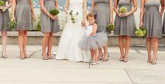 Having the flower girl wear a tutu that corresponds to the bridesmaids' dresses is a unique, adorable idea.