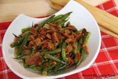 Firecracker Green Beans--make it vegan by using fake bacon strips, vegan buttery sticks and water instead of broth. yummy!