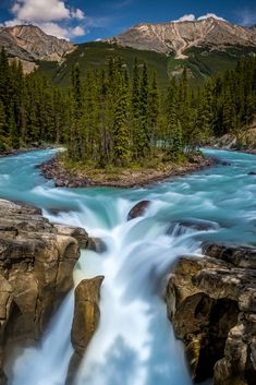 Sunwapta Falls is a pair of waterfalls of the Sunwapta River located in Jasper National Park, Alberta, Canada. The falls are accessible via a 600 metres access road off the Icefields Parkway, which connects Jasper and Banff National Parks. The falls have a drop of about 18.5 metres. #photography #landscape #tips