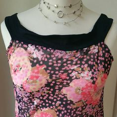 Lux black floral top Polyester and rayon summer top. Strechy bottom. Ties on the side. Great condition. Perfect for summer! Tops Blouses