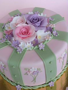 Vintage cake ... soft pastels ... green and pink ... like the arrangement of large roses with small flowers all around ...