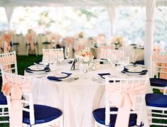 We already have bows and chair covers included for the ceremony. This is a good look to decide if the bows should be light peach or navy (or any other color) instead. The chair covers are white, grey, or black.