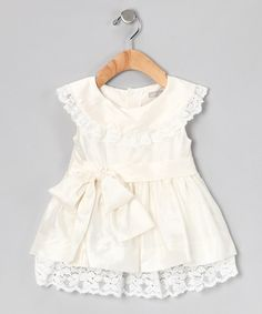 Take a look at this Cream Cookies Bow Dress - Infant & Toddler by Belle Parish