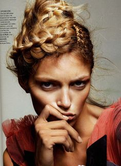 Loving these Katniss-chic braids to round out a Hunger Games-inspired getup!