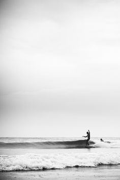 Longboard surfer in black and white