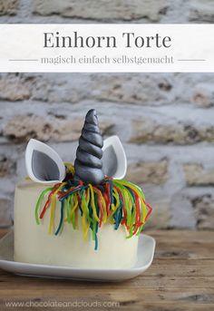 Einfache Einhorn Torten Rezept mit Konfetti Kuchen und weißer Schokoladen Ganache.