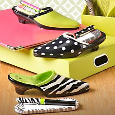"""Sole Mate Note Pad Set.   This ceramic holder gives your everyday note writing and to-do list preparing an inventive twist with its fun shoe shape. A matching pen showcases the same allover pattern as the shoe. Matching notepad ensures you'll have plenty of room to express yourself. Includes notepad holder, pen, and 60-sheet notepad. Comes in its very own gift """"shoe box""""!"""