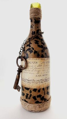 Items similar to Olivia- Vintage Bottle Vase with Leopard Print, Old Music Paper and Large Key, Great for Wedding, Showers and Party Center Pieces on Etsy Wine Bottle Art, Diy Bottle, Bottle Vase, Wine Bottle Crafts, Bottles And Jars, Jar Crafts, Glass Bottles, Altered Bottles, Vintage Bottles