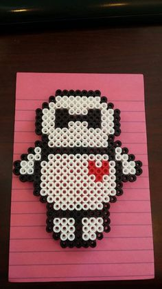 Baymax with heart by - Kandi Photos on Kandi Patterns Perler Bead Designs, Perler Bead Art, Perler Beads, Pony Bead Patterns, Hama Beads Patterns, Beading Patterns, Kandi Patterns, Plastic Bead Crafts, Pony Bead Projects