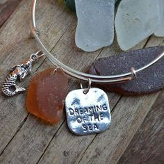 Genuine Irish Seaglass Bracelet Orange seaglass, mermaid, dreaming of the sea charms by MajackalCreations on Etsy Sea Glass Jewelry, Dog Tag Necklace, Irish, Charms, Mermaid, Buy And Sell, Pottery, Bling, Jewellery