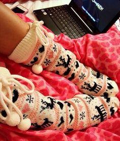 Reindeer, snowflake, and heart pattern fuzzy socks.
