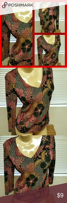 Amazing Floral Stretch Top This top has a gorgeous pattern, made by Notations in a size large, made of a poly spandex blend with nice stretch, bust measures 38 - 44 inches, 25 inches in length from shoulder to hem line, sleeves measure 18 inches from shoulder down, this top is in excellent condition like new Notations Tops