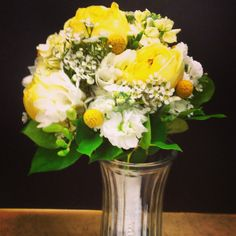 Yellow and White Bride Bq.  Yellow garden roses, yellow billy balls, white and yellow stock and wax flower, white freesia and salal leaves to finish it off