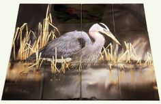 Evening Reflections - Tile Mural A great blue heron looking for dinner in the shallows of a lake. Images of waterfowl on tiles are great to use as a part of your kitchen splash back tile project or your tub and shower surround bathroom tile project. Pictures of egrets on tile, images of herons on tile and decorative tiles with ducks and geese make a great kitchen splash-back idea and are excellent to use in the bathroom too for your shower tile project.