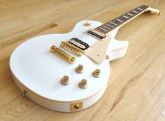 Gibson Les Paul in white with gold hardware.