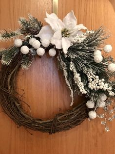 Thinking of a White Christmas? This wonderful Rustic Grapevine Wreath will look perfect in your home for the Holidays! White and Mint Green Embellishments are so beautiful with the brown Grapevine. Love the White glitter poinsettia, Frosted faux pine leaves, pine cones, silver and