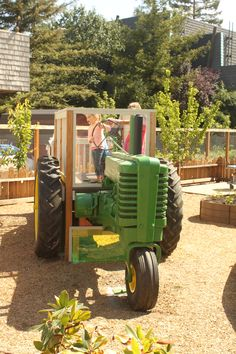Kid-powered tractor at the Nelson Family Farm