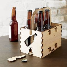 Laser-cut and engraved with an authentic burnished edge, the pieces ship flat and easily fit together like a puzzle to tote six bottles or cans. Also fun for hot sauce, utensils and napkins for a picnic or party on the patio. Built-in bottle opener pops right out of the case to crack open a cold one.