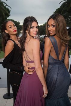 Joan Smalls, Kendall Jenner, and Jourdan Dunn struck over-the-shoulder poses at the amfAR Gala in Cannes. Talk about hot, hot, hot!