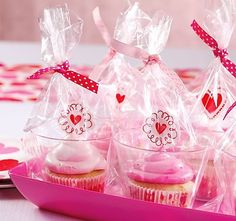 Make sweet presents out of your Valentines Day cupcakes with a cupcake.  Place cupcakes in tumblers, wrap in clear cello bags and tie off with pink polka-dot ribbon – Happy Valentines Day!
