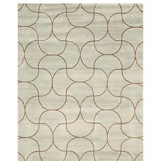 A stunning abstract pattern highlights this hand-tufted wool rug. This area rug features shades of green and brown.