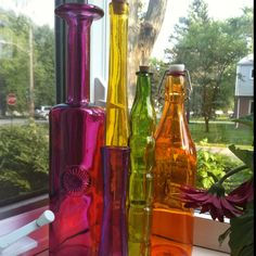 Colored glass bottles- I want to decorated the mantel with these Colored Glass Bottles, Colored Vases, Bottles And Jars, Clear Glass, Glass Art, Genie In A Bottle, Super Cool Stuff, Bottle Trees, Message In A Bottle