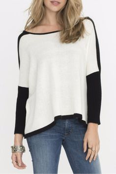 Ivory sweater with black color blocking at the shoulders, through the sleeves, and along the bottom. The black part of the sleeves are ribbed for a more fitted look. Pair with denim or black leggings.   White Colorblocked Sweater by Two Chic Luxe. Clothing - Sweaters - Crew & Scoop Neck Cincinnati, Ohio
