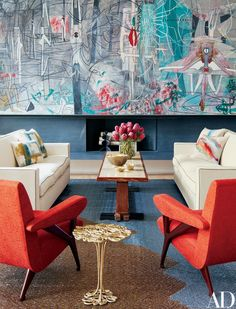 In the living room of Clarissa and Edgar Bronfman's New York apartment, Jean-Michel Frank sofas and a Paul Dupré-Lafon cocktail table are arranged on a Jorge Lizarazo rug crafted to complement the Roberto Matta painting | archdigest.com
