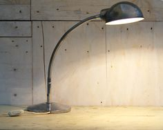 """Ministerial lamp, AP500 type, dating back to the fifties, a classic piece in all offices of the period. The lamp was made of chrome-plated iron, the base is made with very heavy iron on which is engraved """"MINISTRY LAMP TYPE AP 500."""" The arm is flexible and adjustable to 360 °, it is complete with cord and plug, it switches on with the """"tic tac"""" mechanism. This lamp is back in fashion as a piece of furniture because of its simplicity and its form. The chrome is in excellent condition. It…"""