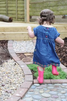 Such a cool idea! Sensory walking path with different materials and textures. Fun for little ones, and it looks great, too!