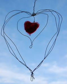 Wire heart.  The tutorial is here:  http://pm-betweenthelines.blogspot.com/2009/02/valentine-wire-wrapped-felted-heart.html