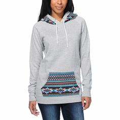 Mix up your basic hoodie look and add the Long Beach Tribal Print pullover hoodie from Empyre Girl to your wardrobe. Built with a slim, longer fit in a Heather Grey colorway, this tunic style hooded sweatshirt from Empyre has a colorful native print at the hood and pocket for some fun style.