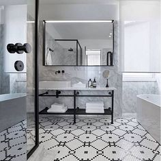 Here's a classically #tiled #bathroomdesign shared by #tile and hard surface specification guru @katewalker_design who found the image via @lucdesign. Photo by PhotoDusko Vlaovic. This #blackandwhite #bathroom beauty is found in the @hotel_adriatic Istria Croatia. We #instalove the combo of calacutta #marble and #mosaic #tiles accented with the #black tapware and shower frame. / #tiletuesday #tiling #tilework #bathroomtile #backsplashideas #interiors #interior #interiordesign…
