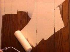 DIY instructions for painting over that ugly wood paneling that it seems every house on the market has in some room! cheap fix that im sure we'll end up doing!