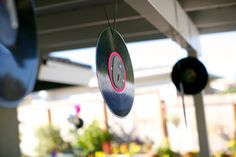 Decor:  Used old records and mounted foam glitter 6 on top of bright cardstock.  Hung all around the patio and umbrellas.
