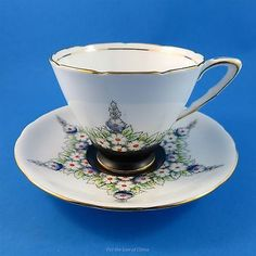 Black with Floral Star Pattern Royal Stafford Tea Cup and Saucer
