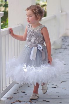 New design for those special occasions!Top bodice is made out soft rosette silver fabric lined with Stunning High Quality Crystals along the top bodice.The back is elasticated for better fitting, double sided satin ribbon that ties into a bow at the back, can be adjusted.Stunning surprise for your precious Princess!Chiffon silver skirt part with White fluffy feathers.Sizes: 9 mos - 5 years Color shown is silver, if you would like another color do please ask.