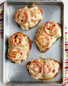 Emeril's Kicked-Up Tuna Melts: Chopped red onion, capers, lemon juice, oregano, and juicy slices of tomato add kicked-up flavor to chef Emeril Lagasse's hot, open-faced tuna sandwiches. Slices of provolone cheese over the top melt beautifully under the broiler.