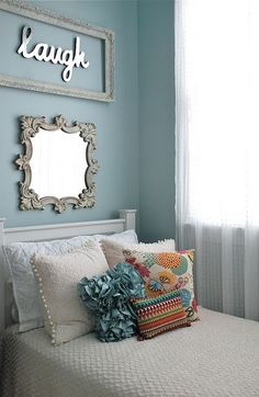 cute way to dress up a small bed in the corner for a small space