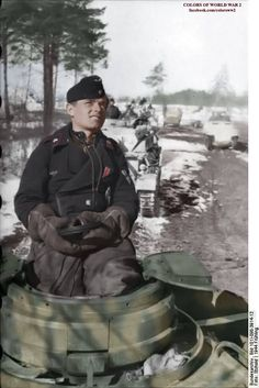 A Panzer soldier is watching some aerial action over his unit as he sits in the open tank turret. Note the heavy winter kit; the gloves barely allow for any dexterous movement. Although this is spring 1944, the winter kit is apparently necessary, especially during the night hours.