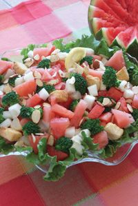 Take a bite of our Beautiful Watermelon Salad. It's extremely refreshing, light, and totally delicious! #salad #vegetarian #recipe