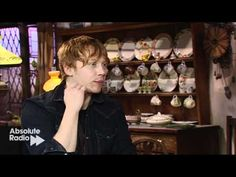 Rupert Grint's interview in the Burrow at The Harry Potter WB Studio Tour grand opening. He IS Ron. I love that he randomly ties his shoe in the first minute or so haha o-o (He's positively awkward... in interviews)
